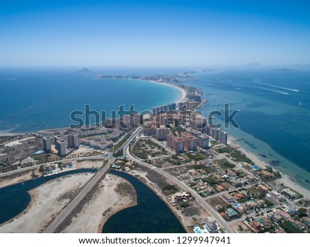 Aerial photo of buildings, villas and the beach on a natural spit of La Manga between the Mediterranean and the Mar Menor, Cartagena, Costa Blanca, Spain. 15