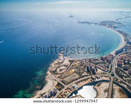 Aerial photo of buildings, villas and the beach on a natural spit of La Manga between the Mediterranean and the Mar Menor, Cartagena, Costa Blanca, Spain. 13