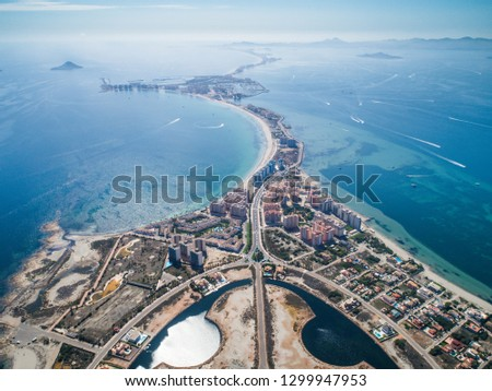Aerial photo of buildings, villas and the beach on a natural spit of La Manga between the Mediterranean and the Mar Menor, Cartagena, Costa Blanca, Spain. 12