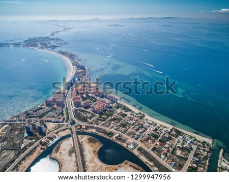 Aerial photo of buildings, villas and the beach on a natural spit of La Manga between the Mediterranean and the Mar Menor, Cartagena, Costa Blanca, Spain. 11