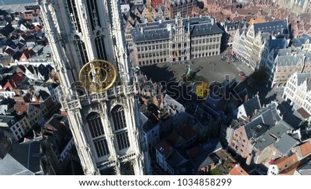 Aerial photo of Cathedral of Our Lady in Dutch Onze Lieve Vrouwekathedraal a Roman Catholic cathedral in Antwerp Belgium in background showing Grote Markt Great Market Square cityhall and guildhalls