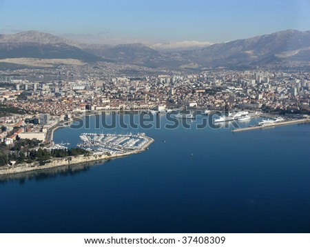 Aerial photo of city Split with harbor - stock photo