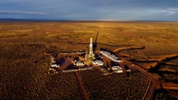 Aerial photo of hydraulic fracturing equipment at sunset. (FRACKING)