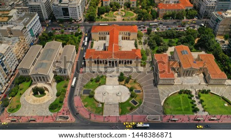 Aerial photo of iconic landmark neoclassic buildings of Academy, University and public Library in the heart of Athens historic centre, Attica, Greece