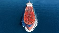 Aerial photo of industrial crude oil - fuel tanker ship cruising deep blue Mediterranean sea