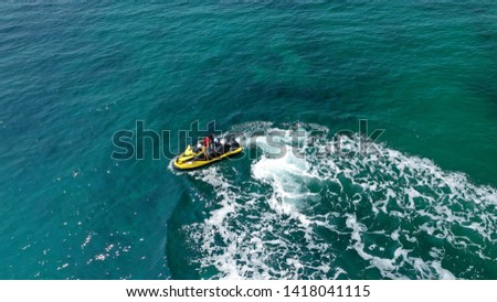 Aerial photo of jet ski with child and teacher cruising in low speed in tropical exotic paradise open sea bay