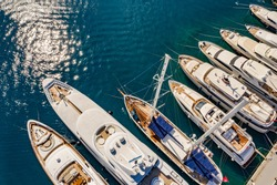 Aerial photo of luxury super yacht marina and sailing boats