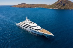 Aerial photo of luxury super yacht on the sea and marina