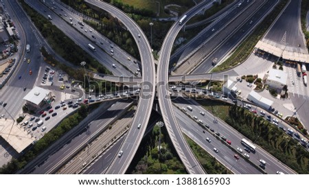 Aerial photo of multilevel elevated highway junction highway passing through modern city in multiple directions #1388165903