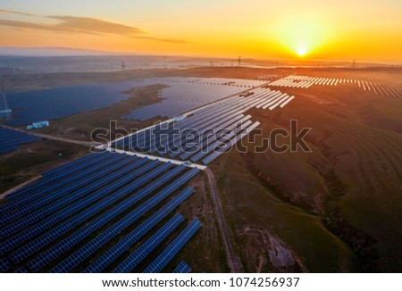 Aerial photo of new energy solar photovoltaic panels outdoors at sunrise #1074256937