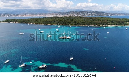 Aerial photo of Plateua du Milieu recreational boats at anchor and Ile Sainte Marguerite which is the largest of Lerins Islands, about half a mile off shore from the French Riviera town of Cannes