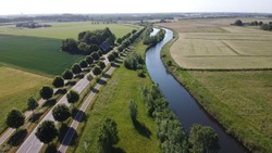 Aerial photo of plattland near Breda in the Netherlands with trees and river off.