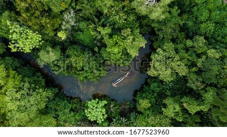 Aerial photo of river in amazon rainforest jungle in Peru