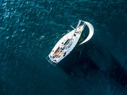 aerial photo of sailboat yacht top view, isolated on the sea texture. participant of sea regatta