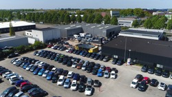 Aerial photo of small temporary car lot to store new cars for resale and car dealers who do not have free space for storage
