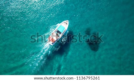 Aerial photo of small vessel cruising in tropical emerald clear sea in Greek Ionian island #1136795261