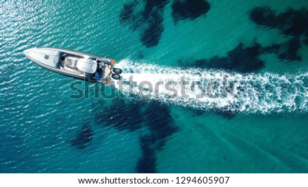 Aerial photo of speed boat cruising in Aegean island, Greece #1294605907