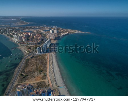 Aerial photo of tall buildings and the beach on a natural spit of La Manga between the Mediterranean and the Mar Menor, Cartagena, Costa Blanca, Spain. 16
