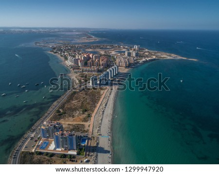 Aerial photo of tall buildings and the beach on a natural spit of La Manga between the Mediterranean and the Mar Menor, Cartagena, Costa Blanca, Spain. 15