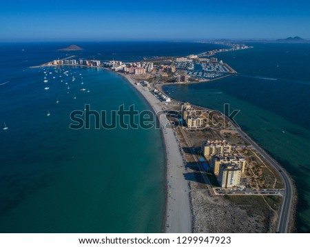 Aerial photo of tall buildings and the beach on a natural spit of La Manga between the Mediterranean and the Mar Menor, Cartagena, Costa Blanca, Spain. 14