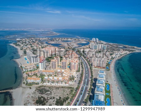 Aerial photo of tall buildings and the beach on a natural spit of La Manga between the Mediterranean and the Mar Menor, Cartagena, Costa Blanca, Spain. 12