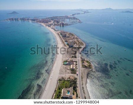 Aerial photo of tall buildings and the beach on a natural spit of La Manga between the Mediterranean and the Mar Menor, Cartagena, Costa Blanca, Spain. 9