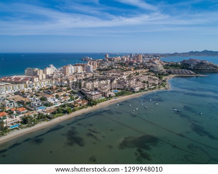 Aerial photo of tall buildings and the beach on a natural spit of La Manga between the Mediterranean and the Mar Menor, Cartagena, Costa Blanca, Spain. 8
