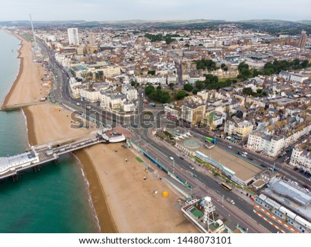 Aerial photo of the Brighton beach and coastal area and the famous Brighton pier located in the south coast of England UK that is part of the City of Brighton and Hove, taken on a bright sunny day
