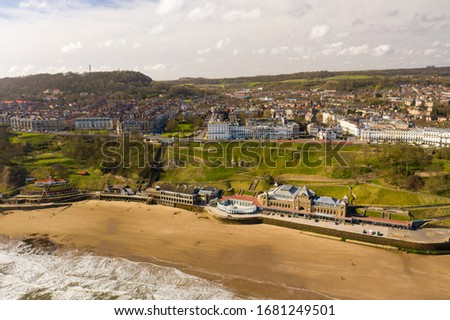 Photo of  Aerial photo of the British seaside town of Scarborough, the seaside coastal town is located in East Yorkshire in the North Sea coast showing the sandy beach front and ocean in the UK