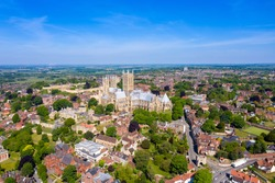 Aerial photo of the city centre of Lincoln and Lincoln Cathedral, Lincoln Minster in the city centre of Lincoln on a bright sunny summers day showing the historic Cathedral Church in the city centre