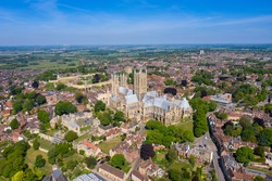 Aerial photo of the Lincoln Cathedral, Lincoln Minster in the city centre of Lincoln on a bright sunny summers day showing the historic Cathedral Church in the city centre