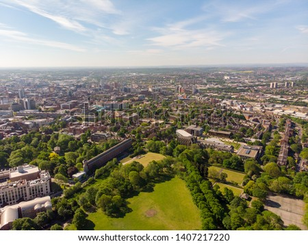 Aerial photo of the town known as Headingley in Leeds West Yorkshire, you can see the Leeds university in the background and the Leeds City Centre taken with a drone on a beautiful sunny day.