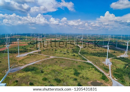 Aerial photo of  wind turbines in fields in Thailand.