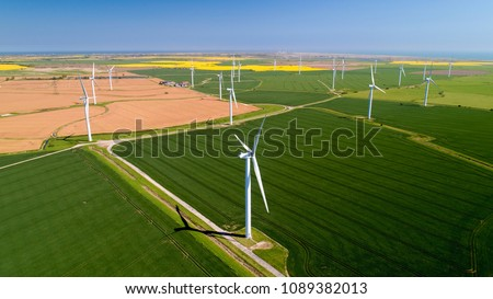 Aerial photo of wind turbines in the fields, Rye, Sussex