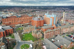 Aerial photo take in the town of Harehills in Leeds just outside the city centre, showing the St James's University Hospital known as Jimmy's showing terrace houses in the background.