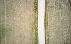 Aerial photograph of a path between fields, abstract effect by straight lines when taken vertically downwards