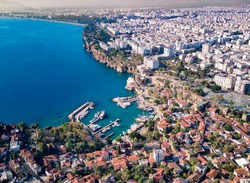 Aerial photograph of Antalya bay in Antalya city from high point of drone fly on sunny day in in Turkey. Amazing aerial cityscape view from birds fly altitude on beautiful town and sea full of yahts