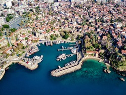 Aerial photograph of Antalya bay in Antalya city from high point of drone fly on sunny day in in Turkey. Wonderful view on the bay full of yachts and boat and with ancient old castle