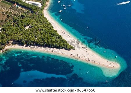 Aerial photograph of famous Zlatni Rat beach in Bol, Brac Island