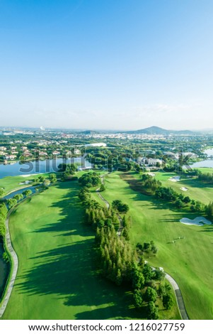 Aerial photograph of forest and golf course #1216027759