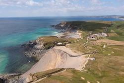 Aerial photograph of Gunwalloe Church Cove and Dollar Cove near the Lizard, Cornwall, England.
