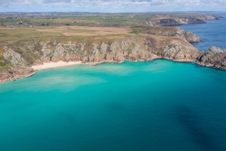 Aerial photograph of Pend Vounder Beach Beach nr Lands End, Cornwall, England.