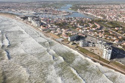 Aerial photograph of the swell and rough seas at Saint-Gilles-Croix-de-Vie 85800, on a very high tide day, located in the west of the Vendée, in the Pays de la Loire region, France.