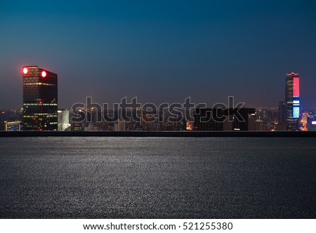 Aerial photography bird view at Empty road floor surface with city landmark buildings background at Shanghai Skyline of night scene