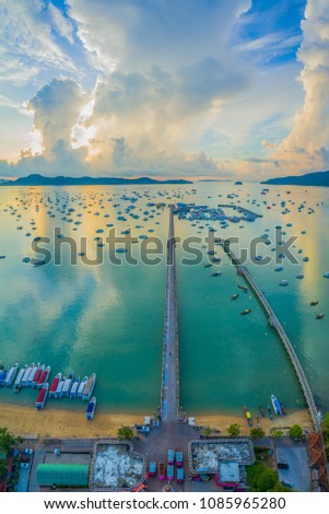 aerial photography cloudy above Chalong pier in the morning. Chalong bay is a center for marina intense boating activity #1085965280