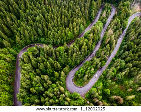 Aerial photography of a road from Transylvania. Aerial photography of a road crossing a forest.