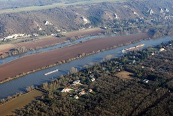 Aerial photography of barges and transport boats sailing on the Seine river, in commune of Haute-Isle en Vexin, Val-d'Oise department (95780), Ile-de-France, France - January 03, 2010