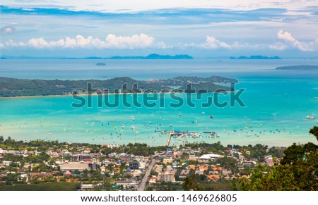 Aerial photography of Chalong pier and bay. Chalong is a center for intense boating activity. Townhouses, vilas, a lot of sailing and motor yachts. Beautiful tropical lagoon panorama. Thailand, Phuket #1469626805