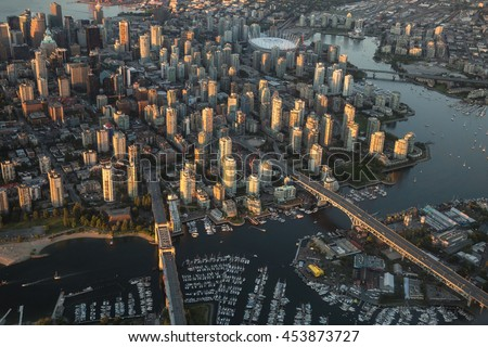 Aerial Photography of False Creek, Cambie Bridge and Granville Bridge in Downtown Vancouver, BC, Canada, on a Hazy sunny sunset.