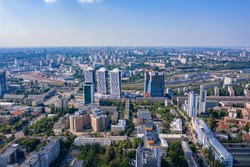 Aerial photography of residential areas of Kyiv with a view of the railway station and new skyscrapers under construction, aerial view, city photography. Copy space.